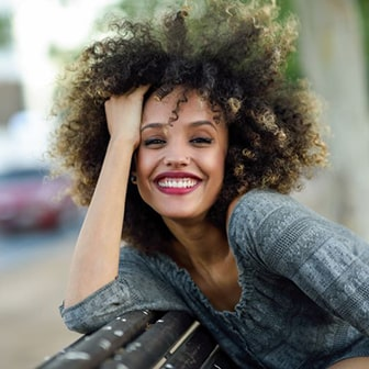 smiling woman with long curly hair