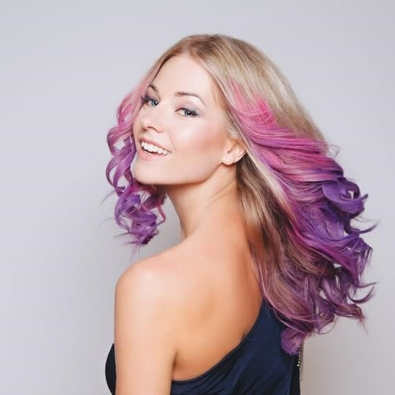 woman with shiny and dyed blond and purple hair
